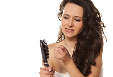 A woman having hair fall issue